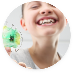 Girl holding retainer