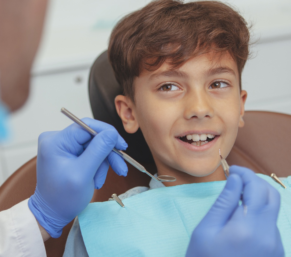 Child getting worked on by dentist